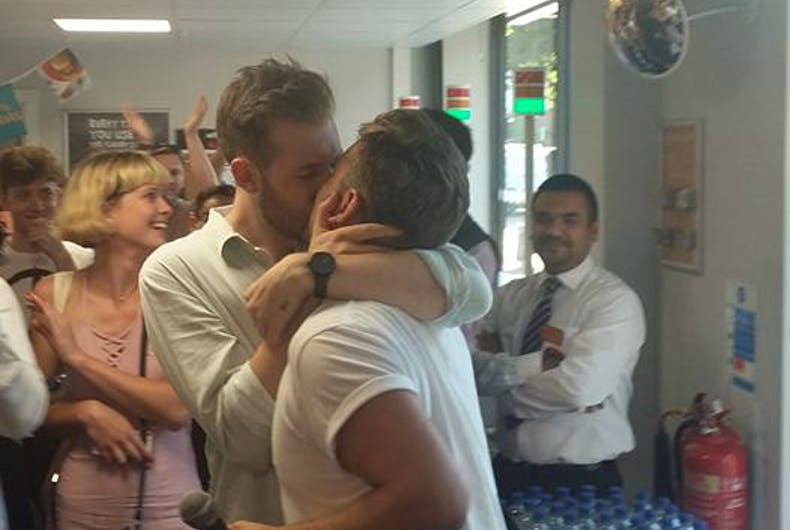 Hundreds stage kiss-in to protest store's eviction of gay couple
