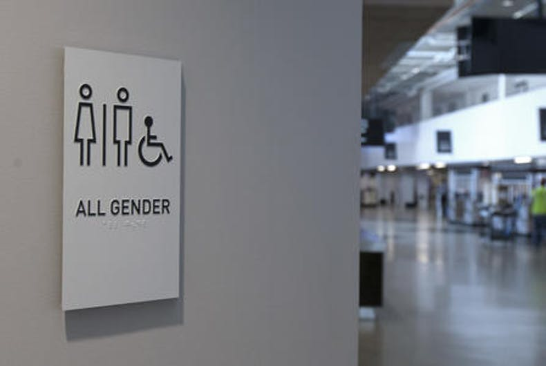A sign marking an all-gender restroom is seen at the new Golden 1 Center in Sacramento, Calif.