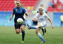 Lesbian soccer star Megan Rapinoe kneels during national anthem