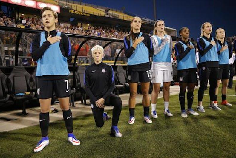 Megan Rapinoe kneels during anthem before US match vs. Thailand