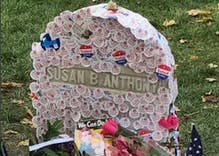 Women cover Susan B. Anthony headstone with 'I Voted' stickers on historic day
