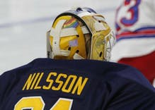 Buffalo Sabres goalie wears pride flag on mask to show support for gay friends