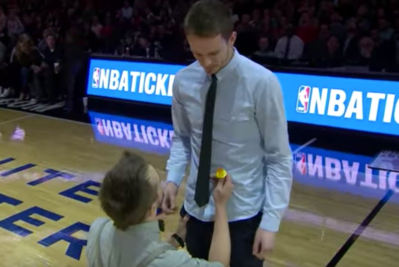 Watch: Gay man proposes with a candy ring during Chicago Bulls game