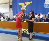 Bullied student accepts his air force diploma in a red dress and heels