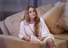 Lindsay Lohan stopped at London airport because she was wearing a headscarf