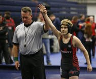 Trans wrestler wins right to compete against other boys, but not at school