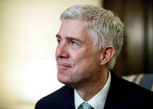 Divisive conservative nominee Neil Gorsuch takes oath as Supreme Court justice