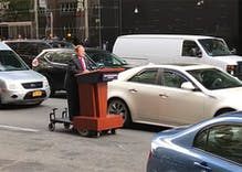Watch out! Melissa McCarthy as Sean Spicer drives her podium through NYC