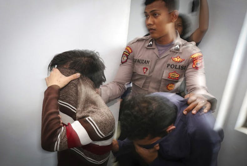 Shariah court sentences gay lovers to public caning