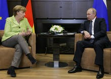 Watch Merkel pressure Putin to stop the purge of LGBTQ people in Chechnya