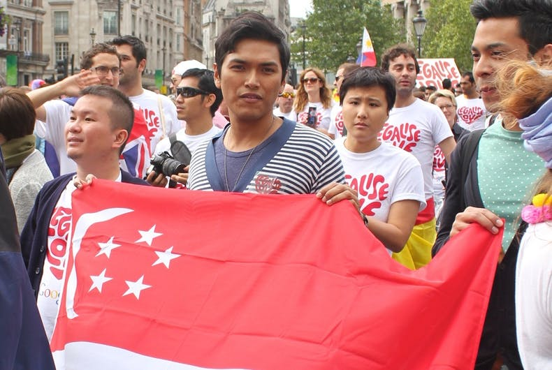People holding up the Singaporean/law/Singapore Upholds Colonial Era Law That Criminalizes Homosexuality