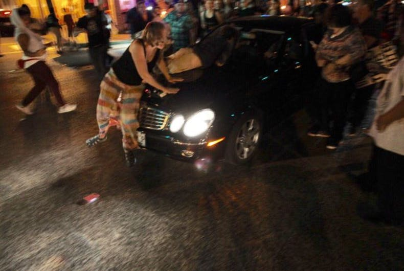 Man who plowed car into transgender protesters charged with felony