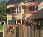 Woman fears for her life as marriage equality opponent starts hurling rocks at her home