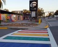 Rainbow crosswalk installed in front of Pulse as part of a memorial to the victims
