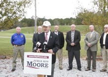 Roy Moore claims 'transgenders don't have rights' as posse of sheriffs stand beside him