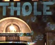 An activist projects 's**thole' & poop emojis on Trump's hotel