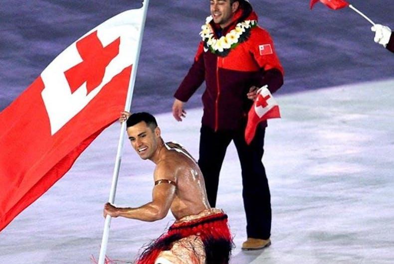 oiled shirtless tonga flag bearer