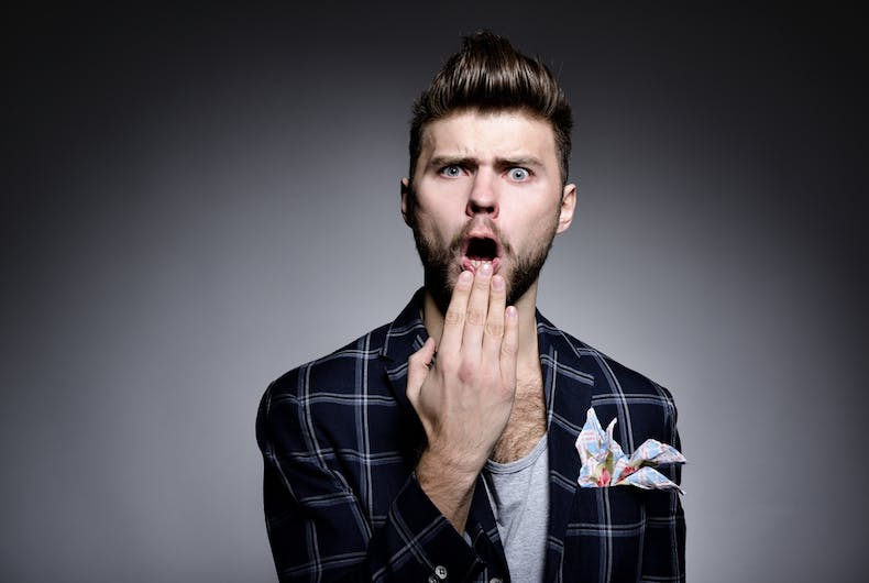 A gay bearded white man looking shocked