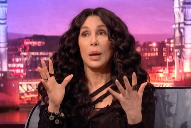 Cher gestures while talking to James Corden.