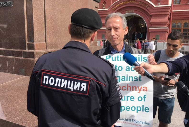 English activist and politician Peter Tatchell being arrested by Russian police during the World Cup.