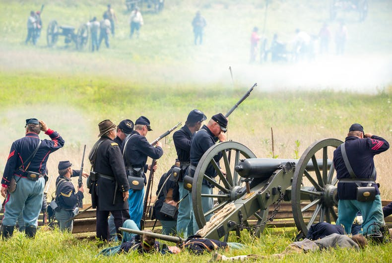 Union soldiers fight during a reenactment of the Civil War Battle of Gettysburg.