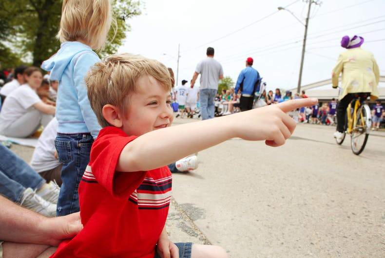 A boy watches a parade go by