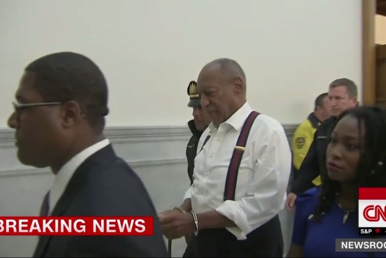 Bill Cosby is led out of court in handcuffs after being found guilty of rape.
