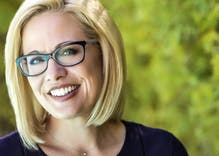 Bisexual Senator Kyrsten Sinema's wigs have conservatives flipping theirs