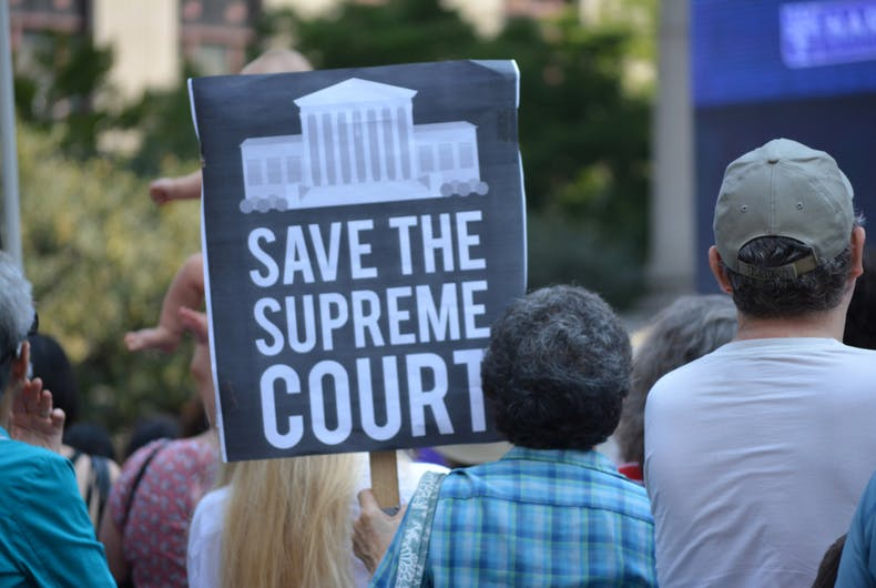 August 26, 2018 - Signs at a Unite for Justice rally against Supreme Court nominee Brett Kavanaugh in Lower Manhattan.