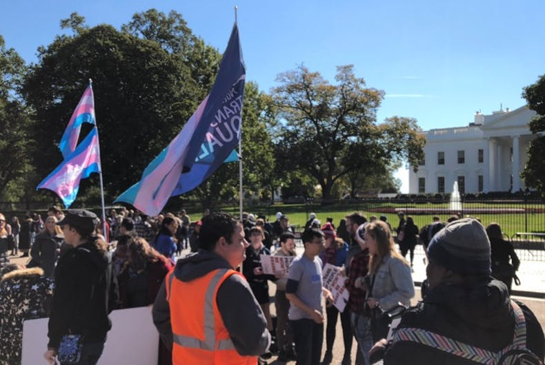 Activists protest outside the White House after news leaks that the administration is considering radically redefining the definition of