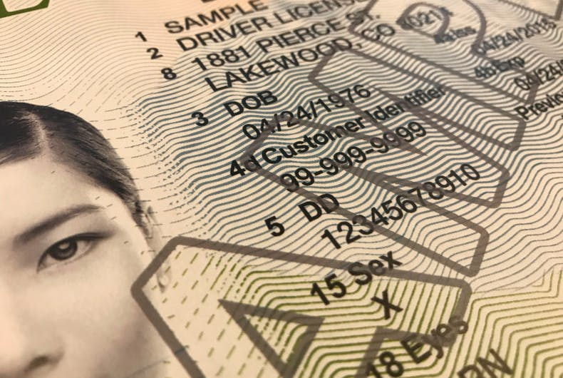 A close up of a sample Colorado drivers license with an