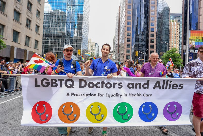 TORONTO, CANADA - JUNE 25, 2017: LGBTQ DOCTOS AND ALLIES march with banner that reads A PRESCRIPTION FOR EQUALITY IN HEALTH CARE at 2017 Toronto Pride Parade.