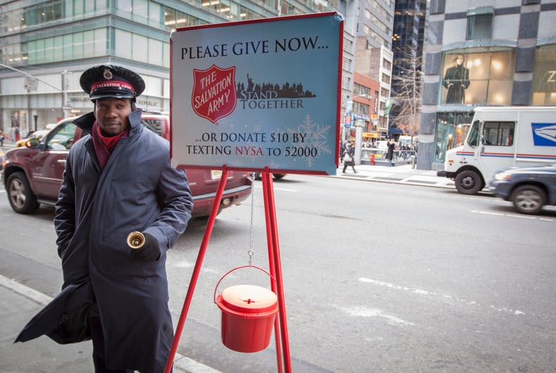 December 22 2010: A Salvation Army soldier rings the bell for donations in midtown Manhattan during Christmas season.