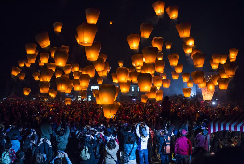 Celebrants release sky lanterns during Taipei's Lantern Festival