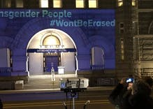 Trans activists projected a message to Donald Trump onto his DC hotel last night
