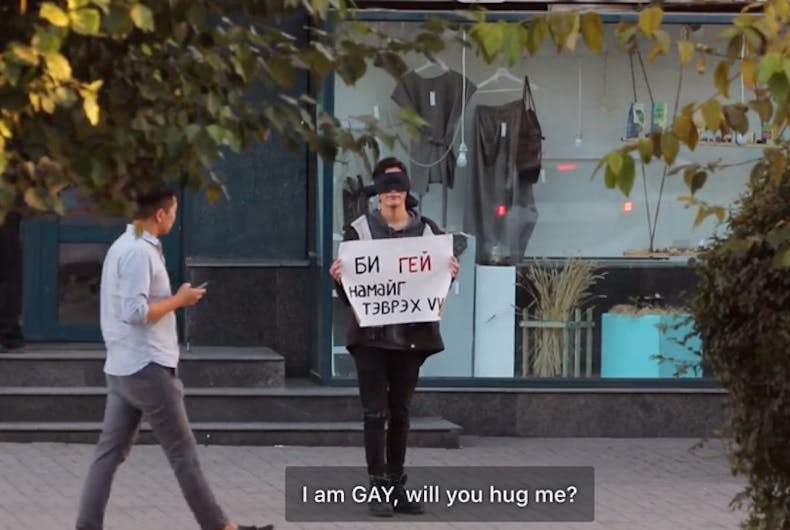 Three queer Mongolians stood outside blindfolded and asking for hugs. Would anyone stop?