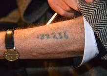 Customs officials are putting numbers on refugees' arms like Nazis did to Jews & gays