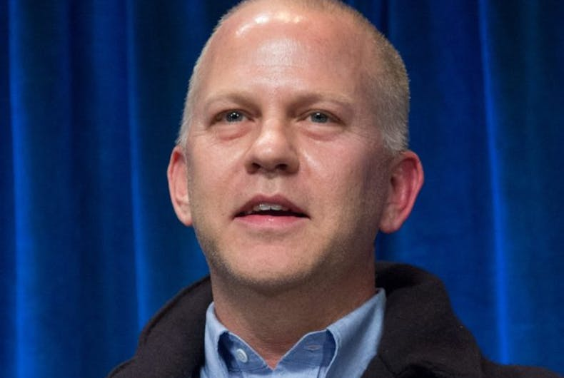 Ryan Murphy in front of a blue background