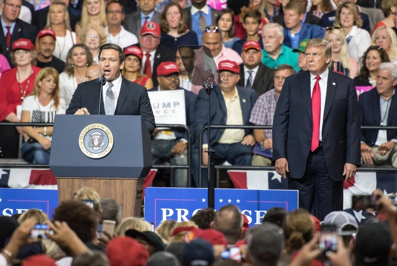 Representative Ron DeSantis addresses a crowd while President Donald Trump watches at a rally in Tampa, Florida, on July 31, 2018