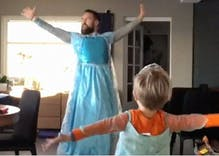 This viral video of a man & his son dancing in dresses to 'Frozen' will melt your heart