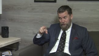Hate group founder Gavin McInnes' wife threatens to sue neighbors over anti-hate signs