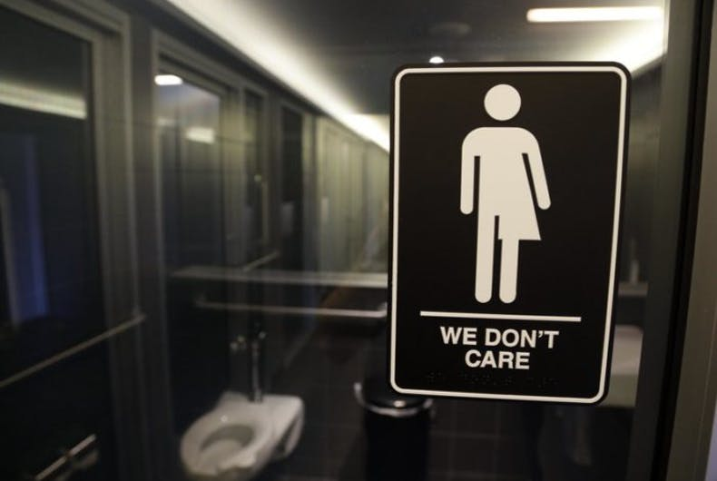 A gender-neutral bathroom sign