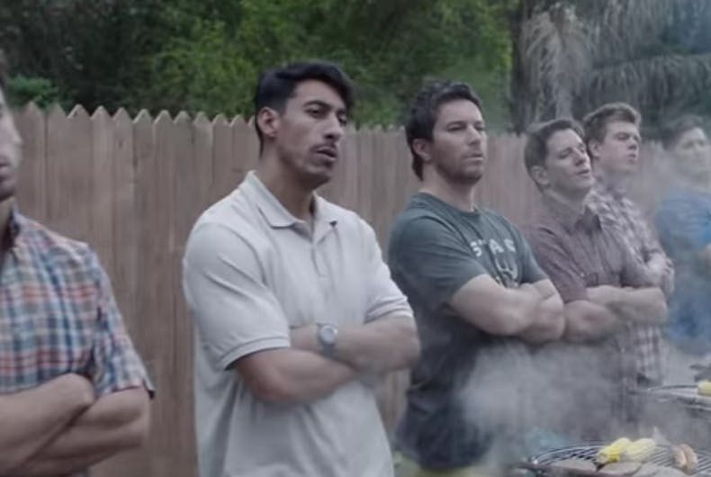 Lots of men in front of barbecues.