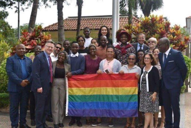Members of Iris Angola standing around a flag