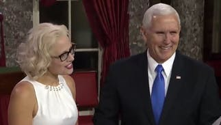 Mike Pence had to swear in America's first bi senator… & she didn't use a Bible