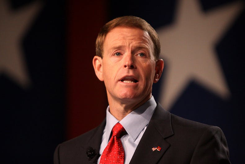 Tony Perkins in a suit and tie.