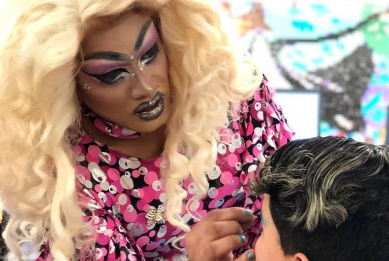 A drag queen applying make up to a kid.