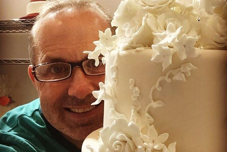 Jay Qualls behind a cake