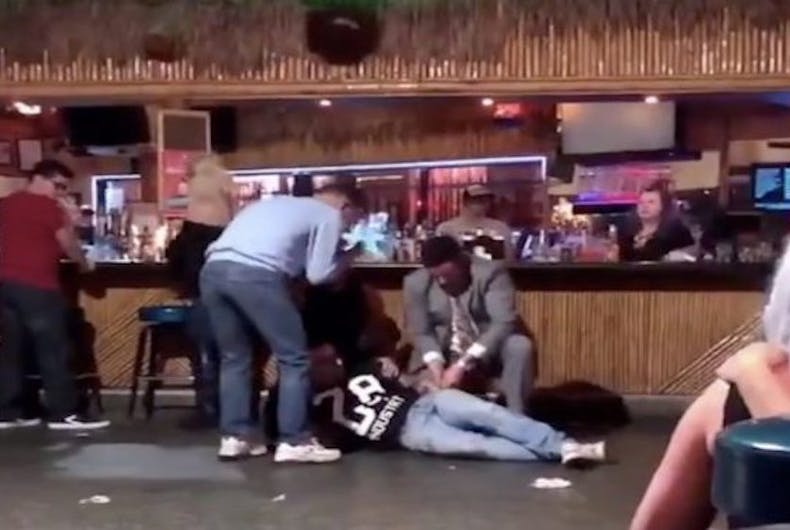Patrons assist a wounded man at Toucan's Tiki Bar in Palm Springs, CA