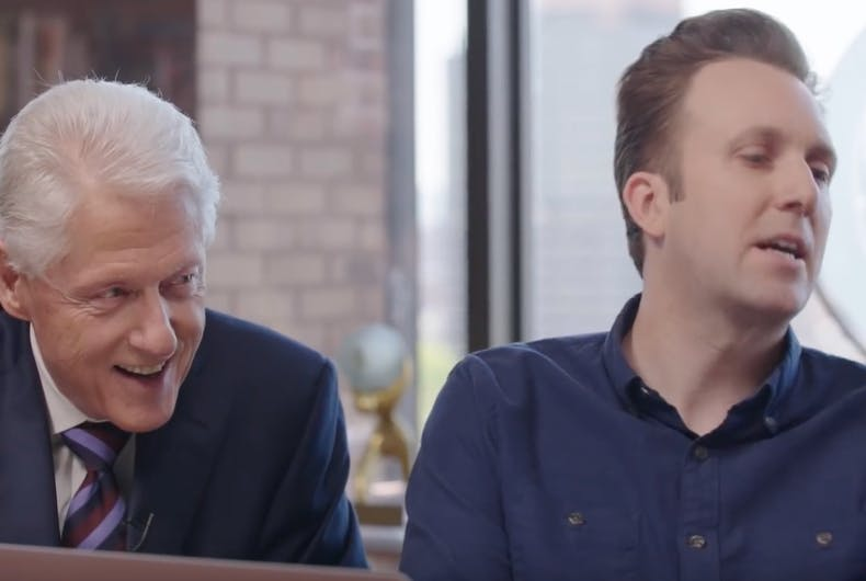 Former President Bill Clinton and Jordan Klepper listen as former presidential candidate Hillary Clinton reads the Mueller report